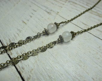 Necklace white pearls on bronze
