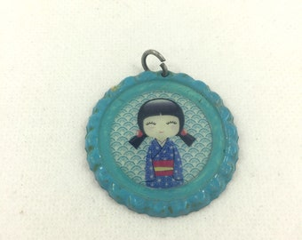 Blue pendant with picture of little geisha