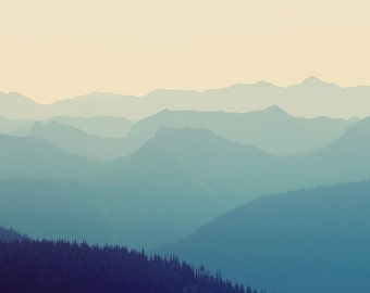 Mountain view photograph, blue and cream, beige, tree covered hills, view point, Mt. Rainier National Park
