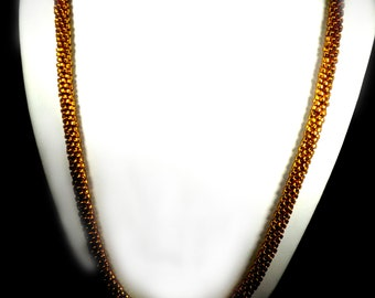 Topaz gold necklace with glass beads beaded on a Kumihimo braid