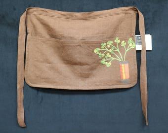 Linen half apron in potting soil brown with cilantro applique
