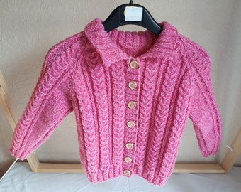 Hand knitted bright pink aran Cardigan with collar