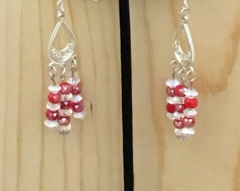 Beautiful silvertone and red crystal chandelier earrings.