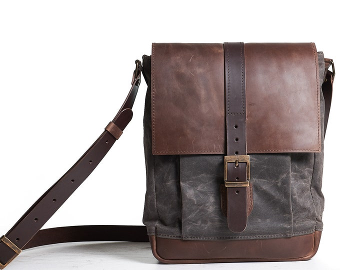 Waxed canvas messenger bag in dark chocolate brown colour.