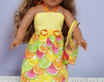 Halter dress for 18 inch dolls. Citrus tutti fruiti print fabric with matching purse.