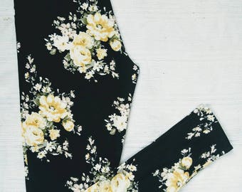 Floral leggings for woman ivory and yellow on black in double brushed polyester with black cotton yoga waistband
