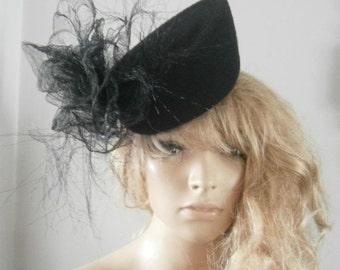black wool felt vintage percher hat in a teardrop shape embellished with a distressed crin sculptured flower detail.