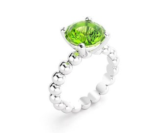 Peridot silver ring set with claws