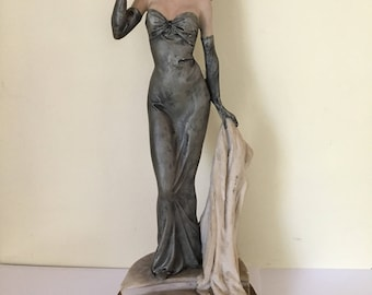 """Vintage woman in 40's style/dress holding wrap 12"""" figurine holding wrap on wood base signed Pucci (from 70s) cast hard cermanic material"""