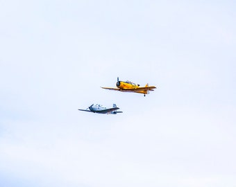 two airplanes flying print