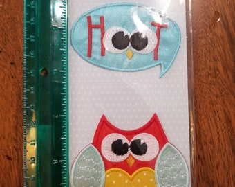 Babyville Boutique Applique 35064  Unopened package 2 appliques An owl and the word Hoot with eyes and a nose. Sew or Iron on 197BO