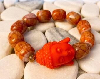 Orange Big Face Buddha