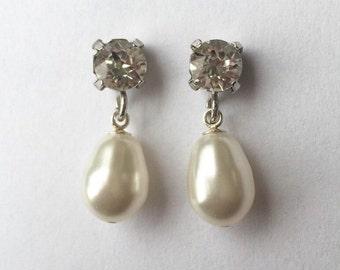 White drop pearl and crystal clear rhinestone earrings. White pearl earrings. Swarovski earrings. Bridal earrings.