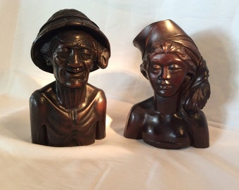 Bali wood carving of man's and woman's head in ebony