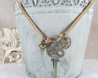 Vintage Found Items charm Dangle necklace on Suede cord
