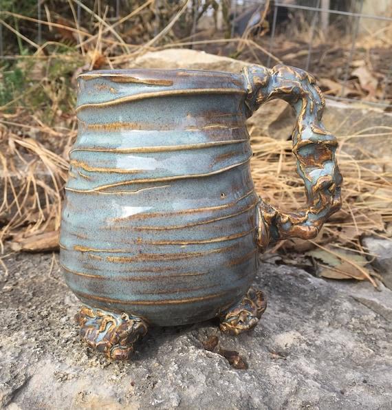 medium sized ceramic mug in glossy blue and beige