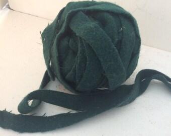 Dark green rug making wool 7/8 wide varying lengths