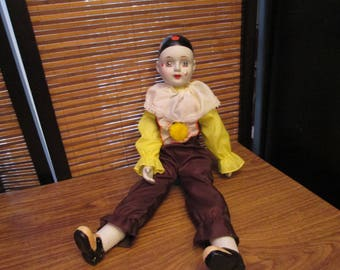 1970s Porcelain China Pierrot Clown Doll Ornament wearing Brown and Yellow Clothes