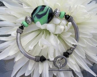 SALE - Sterling Silver Lime Green and Black Lampwork Glass Bead Focal and Swarovski Crystals Bracelet