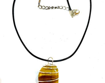 """Large Golden Tigers Eye Crystal necklace within a silver wire spiral cage. 18"""" neclace length."""