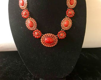 Red necklace and bracelet. Orangish Red floral statement necklace with matching bracelet.