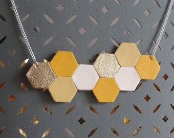 Geometric silver necklace in yellow mustard/ochre and gold leather