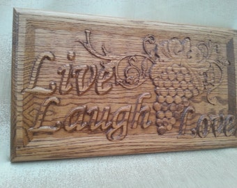 """Carved Wood Plaque with """"Live, Laugh, Love"""" and Grapes"""