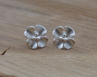 Small silver buttercup earstuds - oxidised and gold plated