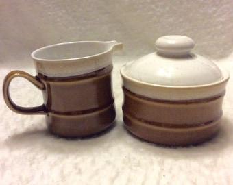 Imperial Stoneware Japan sugar bowl and creamer set.