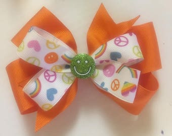 Bright orange, peace, love and happiness bow ~ 5 inches