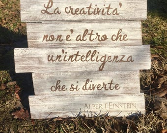 Wooden panel with phrases creative reuse