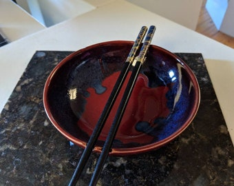 Rice bowl with chopstick holders by Hatfield Pottery in reds and blues