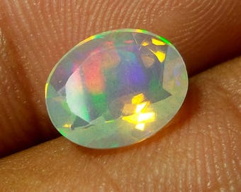 1.3 Carat 10.1x8.4x4.6 MM Natural Faceted Ethiopian Mulit Color Opal Oval Shape Cut Stone, Faceted Ethiopian Play of Color Opal