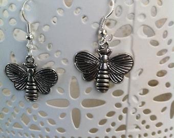Silver bee stud earrings.