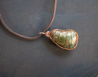 Pear shaped copper wrapped and caged Lake Superior unakite pendant