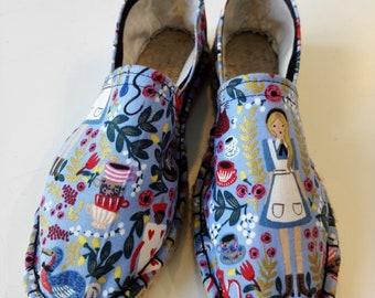 Alice in wonderland light blue espadrilles. Handmade espadrilles. Printed espadrilles with Alice in wonderland motifs. Vegan shoes. Alice