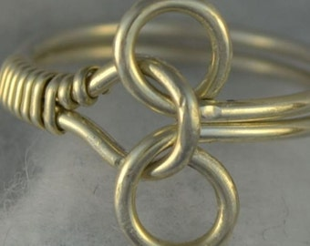 TUTORIAL Puzzle Ring Wire Wrapped -  pdf.   Learn to make this ring.