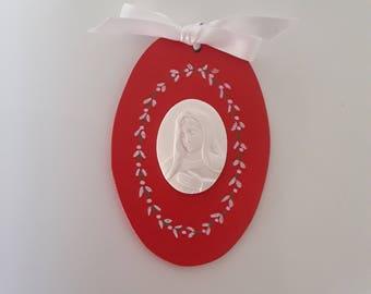 With a Virgin Mary Medallion