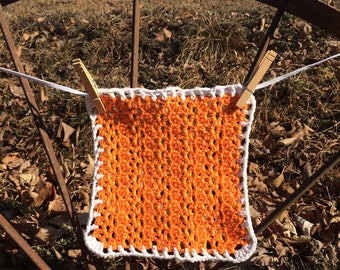 orange and white hand crocheted dishcloth