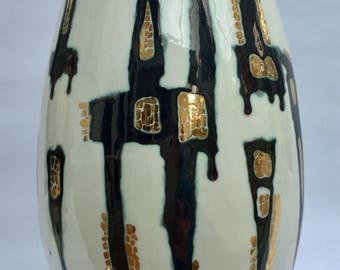 Ceramic vessel with gold lustre.