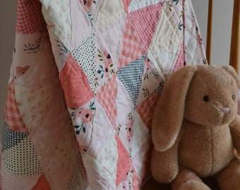 Blush Coral Pink triangle baby quilt with fleece backing