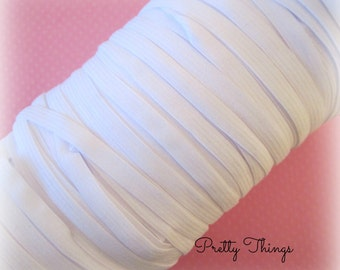 "1/4"" White Elastic. 5 or 25 Yards."