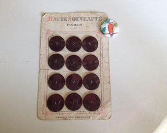 Old plate of 12 Burgundy buttons
