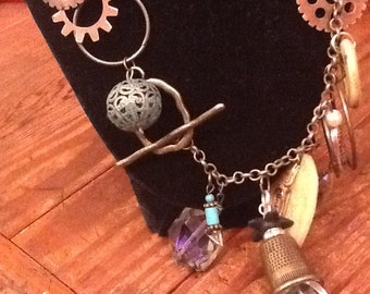 Dangled, charmed necklace