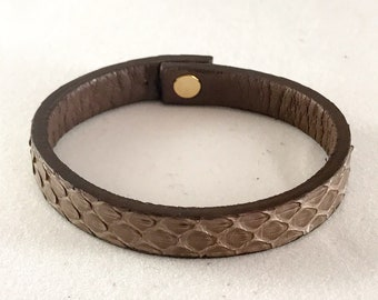 Taupe colored leather strap