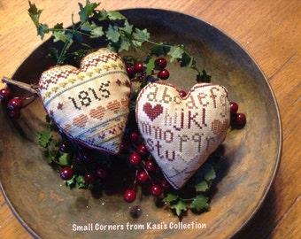 Primitive Sampler Cross-stitched Hearts
