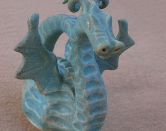 Grand little Dragon made of ceramic clay