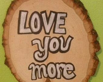 A 'Love you more' Rustic Wood Sign