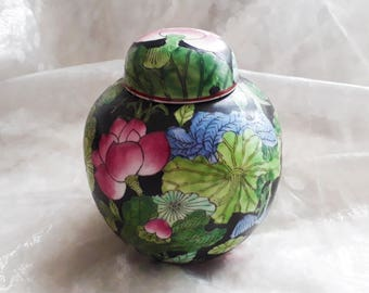Attractive floral ginger jar from China, decorated with pink, green, blue and black hand painted floral design