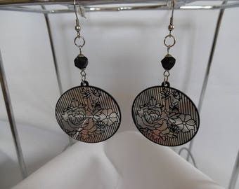 Earrings, large round pieces, black and silver glass beads.
